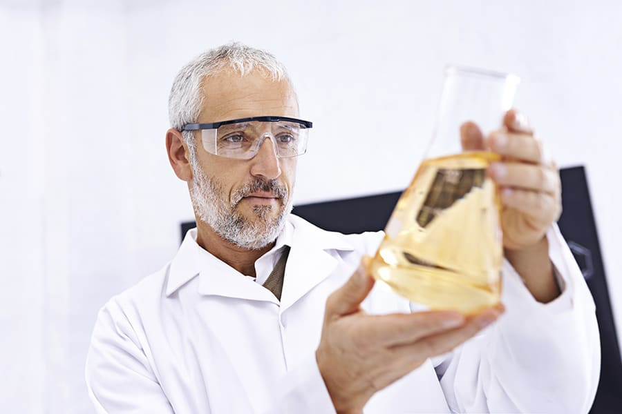 Male scientist examining the results of an experiment in his lab
